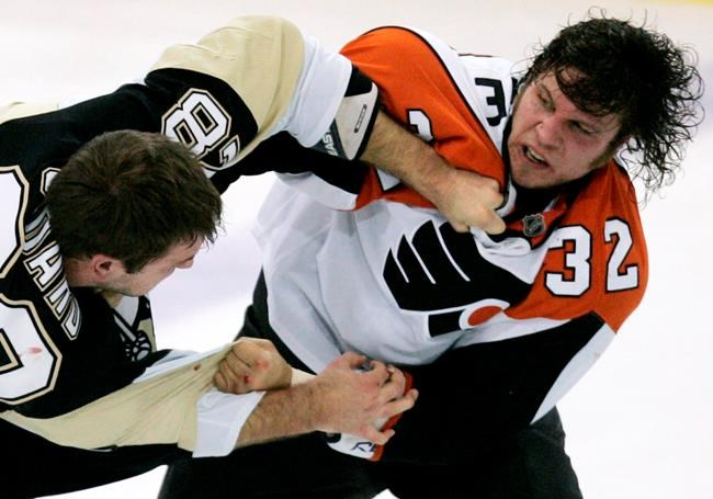 FILE - In this Tuesday, Oct. 14, 2008, file photo, Pittsburgh Penguins' Eric Godard, left, and Philadelphia Flyers' Riley Cote (32) fight in the first period of an NHL hockey game in ...</p> 			</div><!-- .entry-content -->  	<footer class=